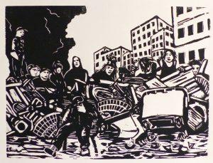 Image d'une barricade, avec les personnes devant et sur la barricade.